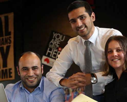 Refugee Intern co-founders Nirary Dacho and Anna Robson with the chief executive of Welcome to Australia, Mohammad Al-Khafaji (centre). Picture: Dean Martin